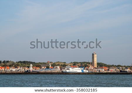 Skyline of West-Terschelling town and harbour, and lighthouse Brandaris on West-Frisian island Terschelling Netherlands - stock photo