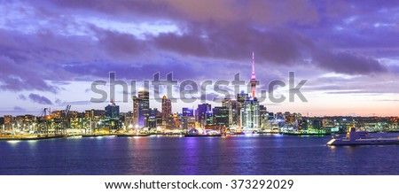 Skyline photo of the biggest city in the New Zealand, Auckland. Panoramic photo was taken after sunset across the bay - stock photo