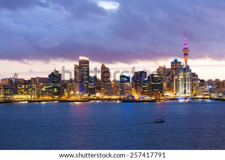 Skyline photo of the biggest city in the New Zealand, Auckland. The photo was taken after sunset across the bay - stock photo