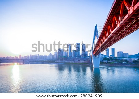 skyline,river and bridge during sunset  - stock photo