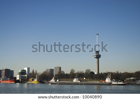 Skyline Rotterdam with euromast and canal - stock photo