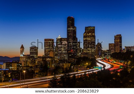 Skyline Seattle at Dusk with the Freeway in Foreground - stock photo