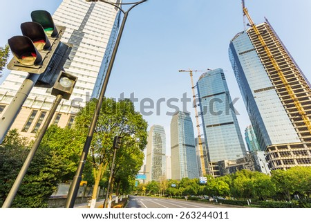 skyline,urban road and office building at daytime. - stock photo