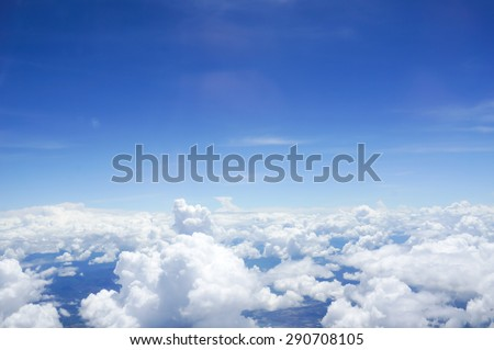 Skyline View above the Clouds from air plane  - stock photo