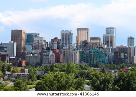 Skyline view of highrise office and apartment buildings in Calgary, Alberta, Canada with greenery in the foreground - stock photo