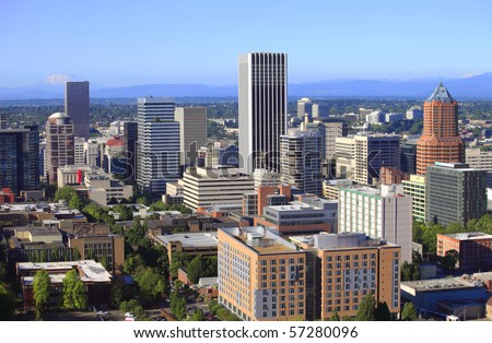 Skyline view of Portland Oregon w/Mt. St.Helen's & Mt. Adams in the background. - stock photo