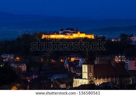 Skyline view over the small fortress of Brasov situared uppon a hill in ther center of the city - stock photo
