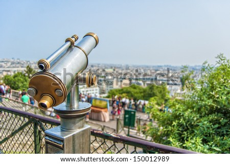 Skyline view with a telescope, observation deck of the Montmartre, Paris, France