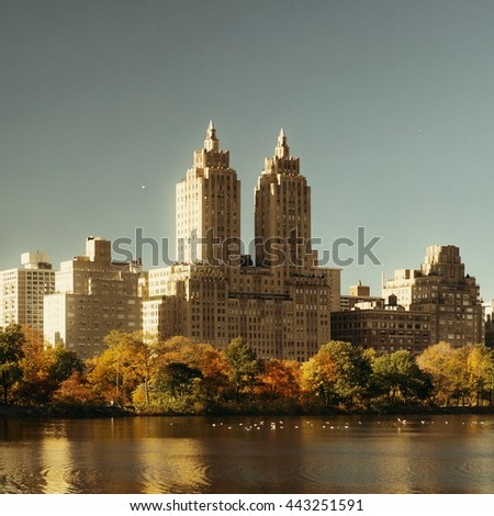Skyline with apartment skyscrapers over lake in Central Park in midtown Manhattan in New York City - stock photo