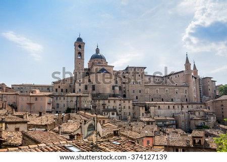 skyline with Ducal Palace in Urbino, Italy. The historic center of Urbino was declared a Unesco World Heritage site and represents the apex of Renaissance architecture - stock photo