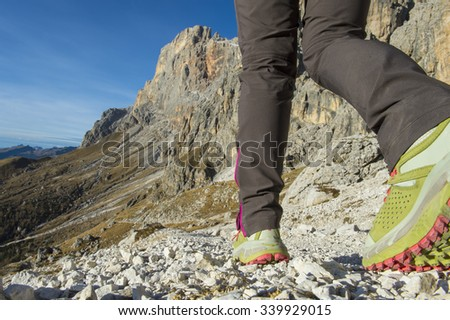skyrunner or hikers in the Dolomites on the go - Italy - stock photo