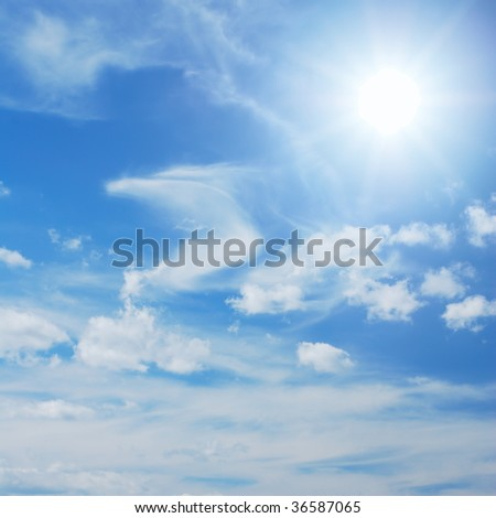 Skyscape with sun shining among little clouds