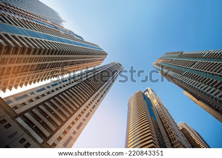 skyscraper against sky ; building glass background - stock photo