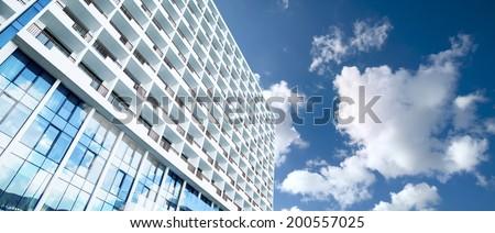 skyscraper against sky ; building glass background ; square  - stock photo