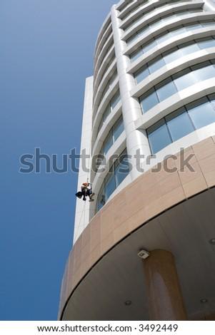 Skyscraper and the washerman of windows. - stock photo