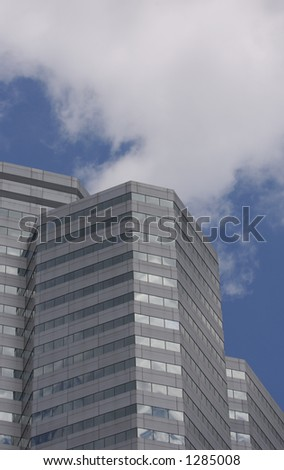 Skyscraper Detail with Blue Sky and Clouds - stock photo