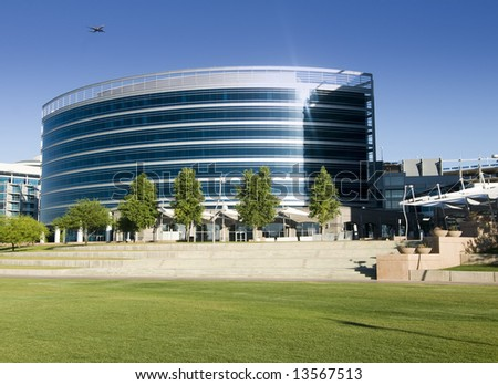 Skyscraper development in downtown Tempe, AZ located by town lake, with aircraft in sky. - stock photo
