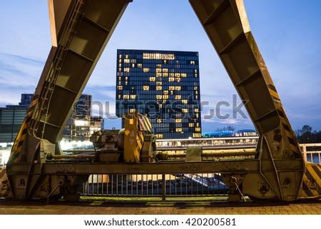 Skyscraper framed through an old harbor crane in Dusseldorf. - stock photo