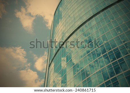 skyscraper, high-rise office building from glass and metal, instagram image style - stock photo