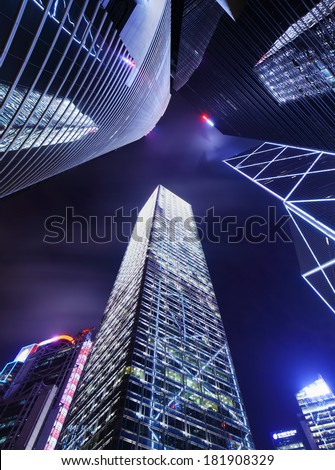 Skyscraper in Hong Kong from low angle at night - stock photo