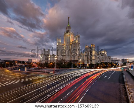 Skyscraper on Kotelnicheskaya Embankment and Traffic Trails at Dusk, Moscow, Russia - stock photo