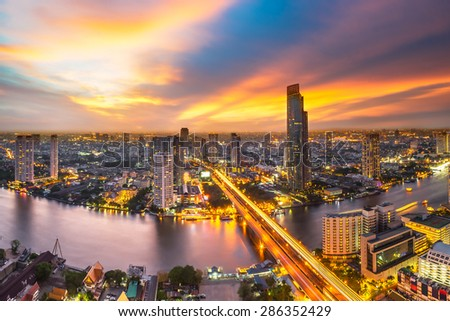 Skyscraper on night scene cityscape at Chaopraya river in Bangkok metropolis Thailand - stock photo