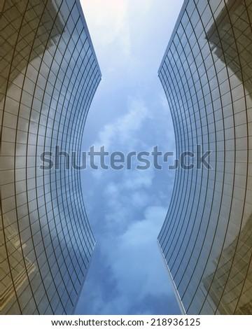 Skyscraper's glass walls - stock photo