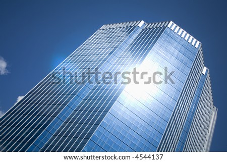 skyscraper under blue sky - stock photo