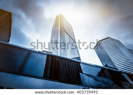 skyscraper under sunlight against the cloudy sky