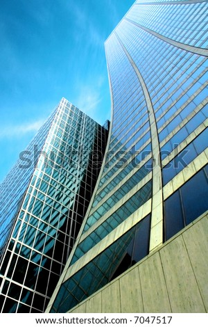 Skyscraper with a dramatic blue sky - stock photo