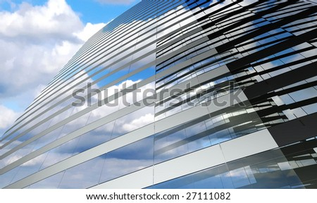 Skyscraper with clouds reflection