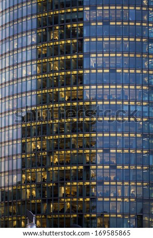 Skyscraper with office windows and glass background in Berlin, Germany - stock photo