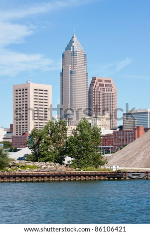 Skyscrapers:  A group of tall buildings that are part of the downtown financial district in Cleveland, Ohio with the Cuyahoga River in the foreground