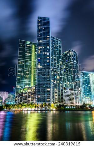 Skyscrapers along the Miami River at night, in downtown Miami, Florida. - stock photo