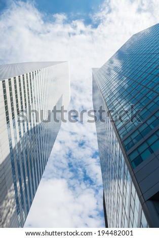 Skyscrapers and cloudy sky. - stock photo