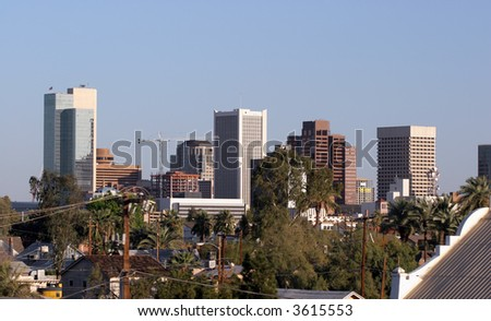 Skyscrapers and Single Family Houses Roofs in Downtown of Phoenix, AZ - stock photo
