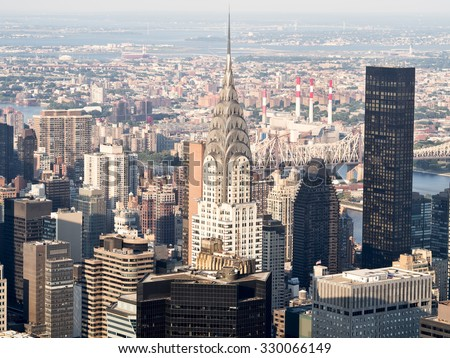 Skyscrapers at midtown New York City with the East River on the background - stock photo