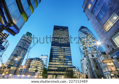 Skyscrapers at the City of London at night. - stock photo