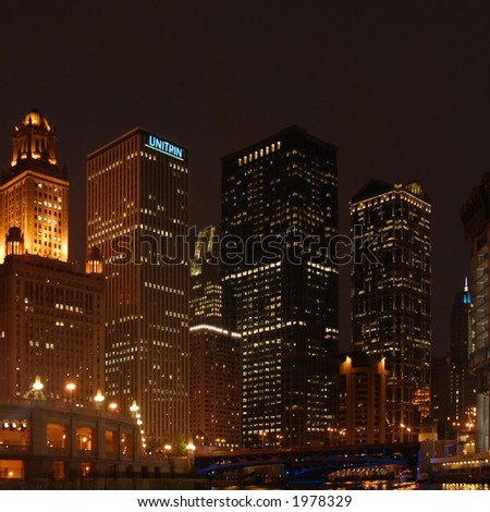 Skyscrapers by night in downtown Chicago, Illinois - stock photo