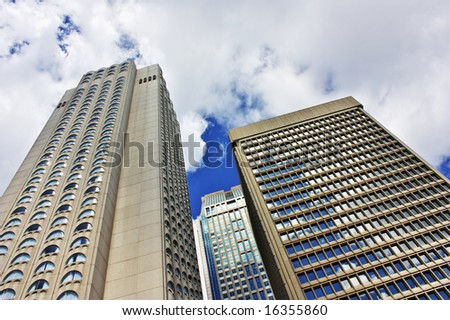 Skyscrapers in downtown montreal on a beautiful cloudy sky - stock photo
