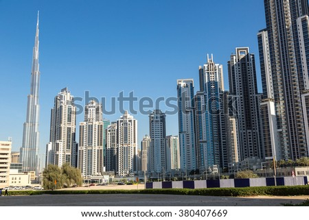 Skyscrapers in Dubai in a summer day - stock photo