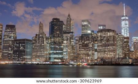 Skyscrapers in Manhattan at night, New York City - stock photo