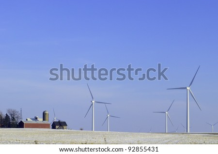 Skyscrapers in the countryside: Wind turbines on wintry farmland in Illinois