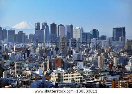 Skyscrapers in the Shinjuku Ward of Tokyo with Mt. Fuji visible. - stock photo