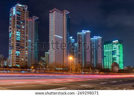 Skyscrapers lit up at as evening comes on in Bundang on the outskirts of Seoul, South Korea. - stock photo