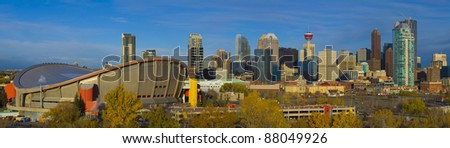 Skyscrapers of Calgar,y Alberta, Canada, with Olympic Saddle Dome in foreground - stock photo