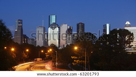 Skyscrapers of Downtown Houston at Sunset, seen from Memorial Parkway - stock photo