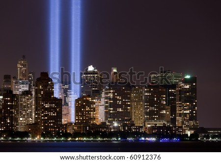 """Skyscrapers of Downtown NY City night shot over Hudson river(view from Jersey City)  """"Tribute in Light"""" 9/11 memorial - stock photo"""