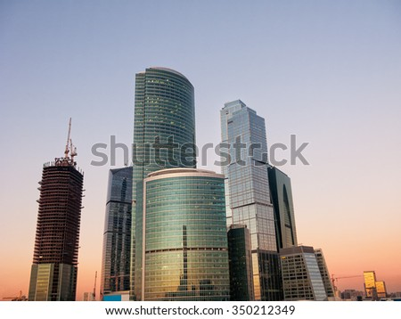 Skyscrapers of Moscow-City International Business Center on construction site at sunset. Moscow, Russia.