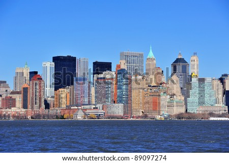 Skyscrapers of New York City Manhattan downtown with urban city skyline over Hudson River with blue clear sky - stock photo